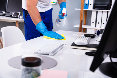 Cleaning and sanitizing office desk